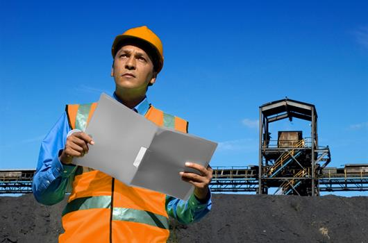 Worker with construction plan.