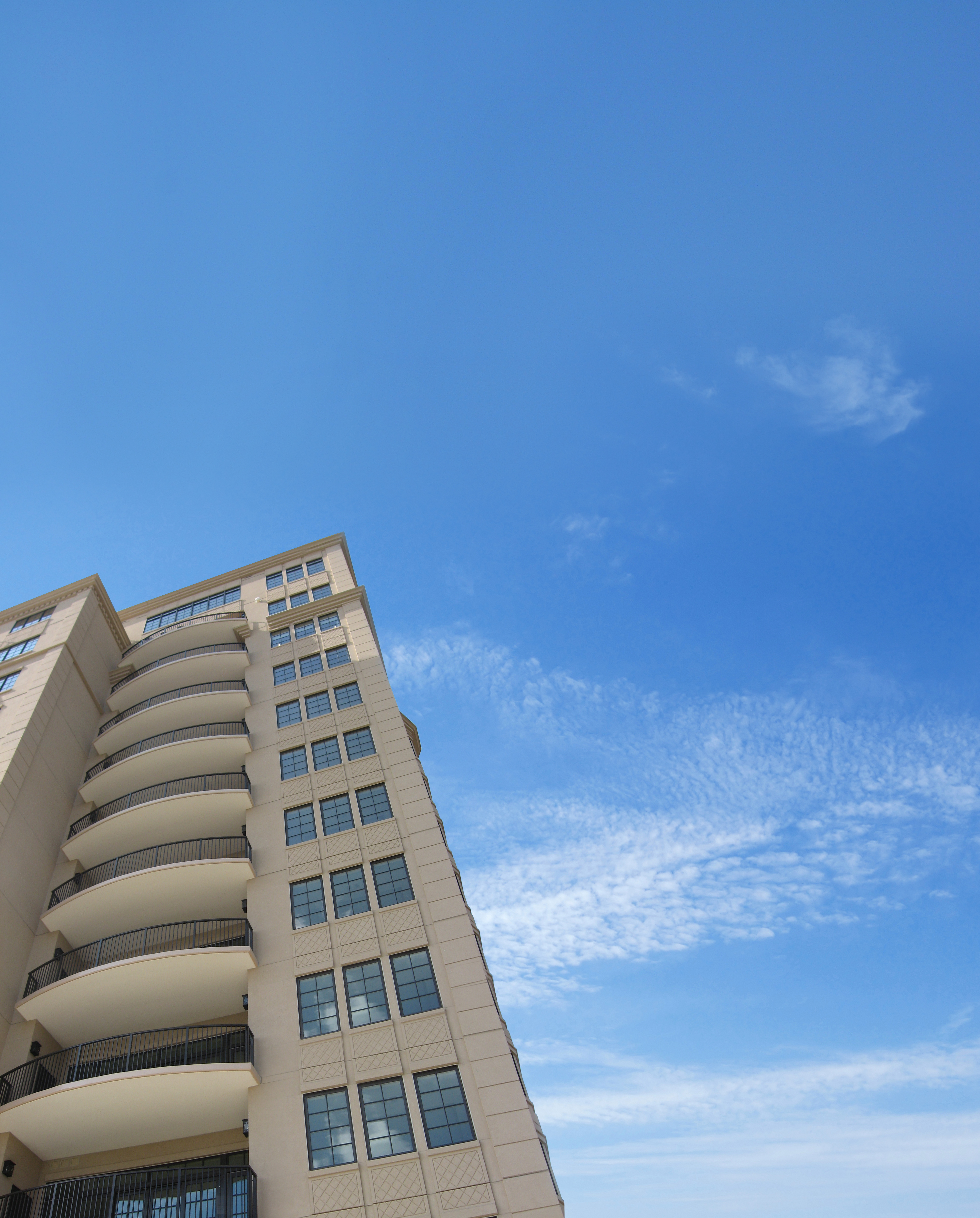 High rise building with a high build protective coating intended to withstand natural elements.